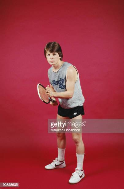 American actor Michael J. Fox poses with a tennis racket and a 'Family Ties' t-shirt, circa 1985. Fox starred in the popular TV series from 1982 to...