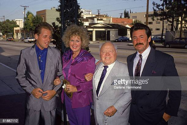American actor Mickey Rooney and eighth wife Jan Chamberlin with her sons and his stepsons Mark and Chris on a street 1980s