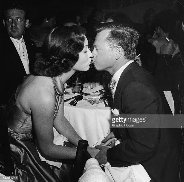 American actor Mickey Rooney and fourth wife actress Elaine Devry kiss at Ciro's Hollywood California July 1953 Rooney was Devry's second husband