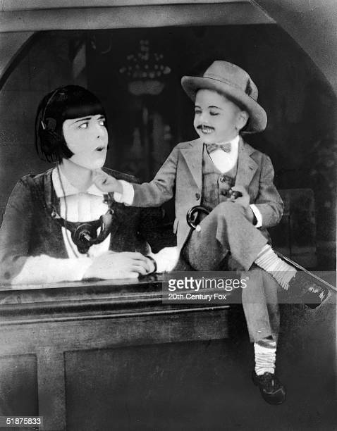 American actor Mickey Rooney as a midget and an unidentified actress in a doctored still from his first movie 'Not to be Trusted' 1926