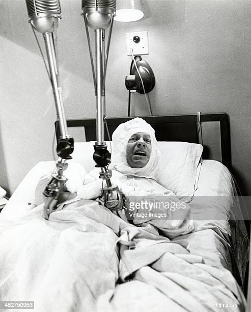 American actor Mickey Rooney lies in a hospital bed in a scene from the comedy film 'The Atomic Kid' 1954