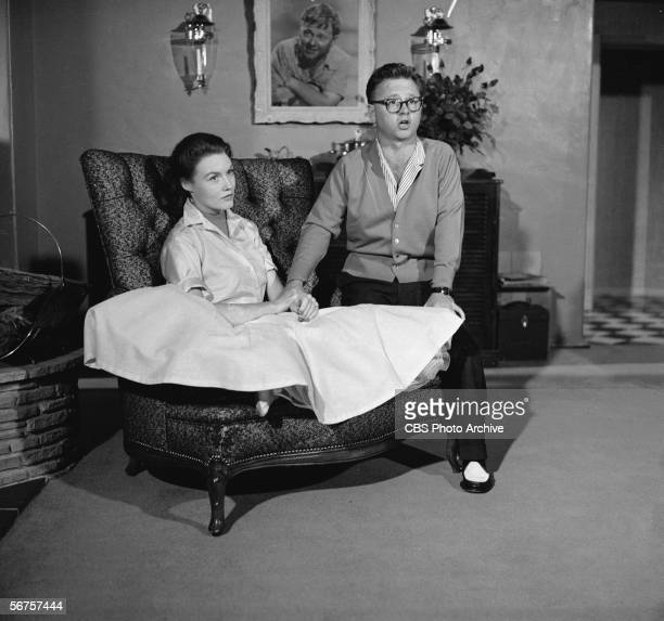 American actor Mickey Rooney poses with his wife Elaine Devry on a episode of the Edward R Murrowhosted interview show 'Person to Person' May 4 1956
