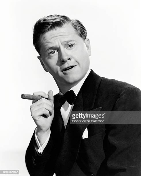 American actor Mickey Rooney posing with a cigar circa 1945