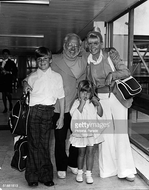 American actor Mickey Rooney with his seventh wife Carolyn Hockett and two children from a previous marriage Jimmy and Jonella pose for a photograph...
