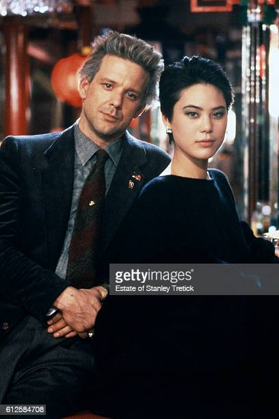 American actor Mickey Rourke and actress Ariane Koizumi on the set of Year of the Dragon based on the novel by Robert Daley and directed by Michael...