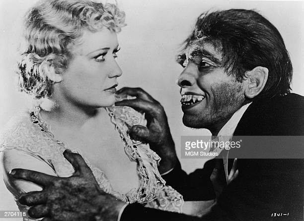 American actor Miriam Hopkins reacts with fright as she is grabbed by the shoulders by actor Fredric March portraying the monster Mr Hyde in a still...