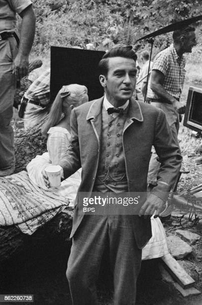 American actor Montgomery Clift in costume on the set of the American Civil War film 'Raintree County' in Indiana USA 1956 Behind him is costar Eva...