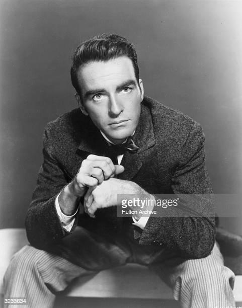 American actor Montgomery Clift wears a suit and bow tie in a promotional portrait for the film 'The Heiress'