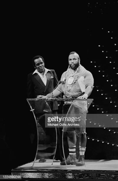 American actor Mr T with singer Lou Rawls during the 1985 Black Gold Awards in Los Angeles, 1985.