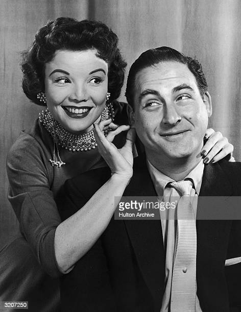 American actor Nanette Fabray smiles while tugging at the earlobe of American comedian Sid Caesar in a promotional portrait for the television series...