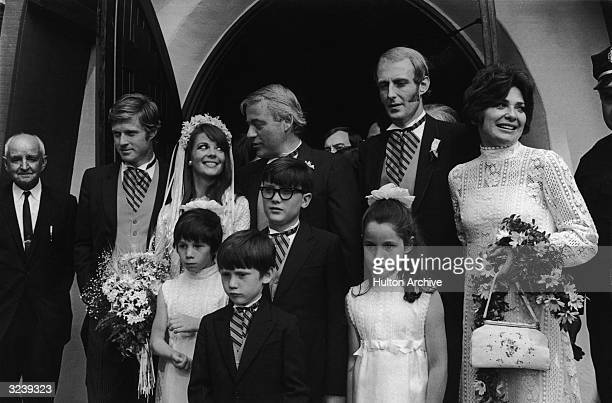 American actor Natalie Wood and her husband producer Richard Gregson pose with family and friends during their wedding ceremony 1969 Back row Robert...