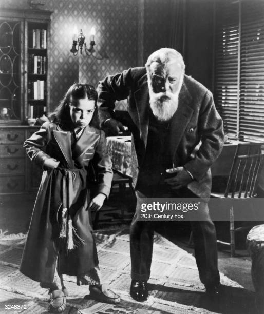American actor Natalie Wood and Welsh born actor Edmund Gwenn make faces while pretending to be monkeys in a still from the film 'Miracle on 34th...