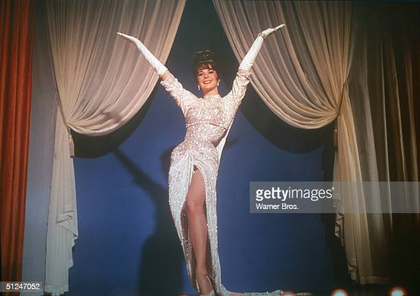 1962 American actor Natalie Wood performs onstage wearing a white sequined dress in a still from the film 'Gypsy' directed by Mervyn LeRoy
