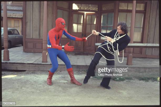 American actor Nicholas Hammond as the costumed superhero Spiderman wrangles a villian in an episode of the CBS television series 'The Amazing...