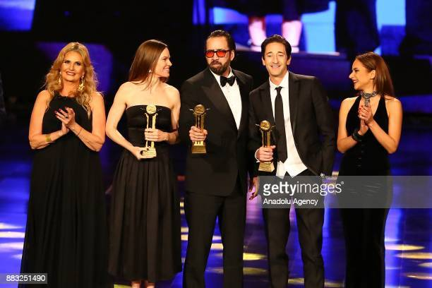 American actor Nicolas Cage , American actor Adrien Brody and American actress Hilary Swank receive the honor award during the closing ceremony of...
