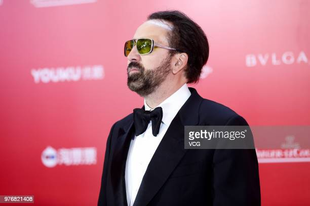 American actor Nicolas Cage arrives at red carpet during the opening ceremony of the 21st Shanghai International Film Festival at Shanghai Grand...