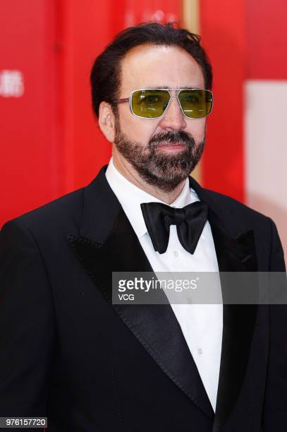 American actor Nicolas Cage arrives at the opening ceremony of the 21st Shanghai International Film Festival at Shanghai Grand Theatre on June 16...
