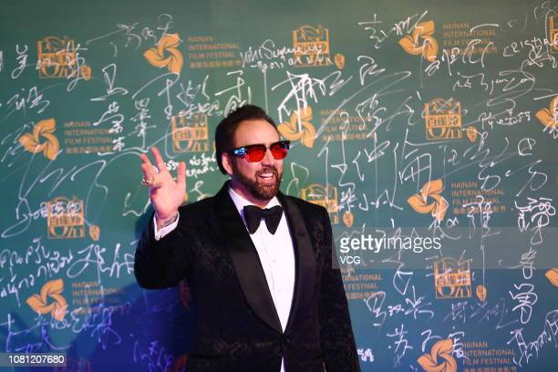 American actor Nicolas Cage poses on the red carpet during the opening ceremony of the 1st Hainan International Film Festival on December 11 2018 in...
