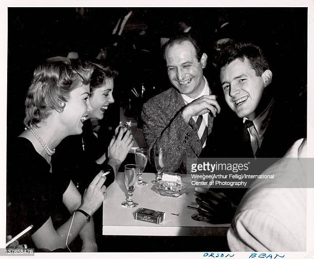 American actor Orson Bean shares a laugh and a drink with unidentified others mid twentieth century Note that the image was developed backwards...