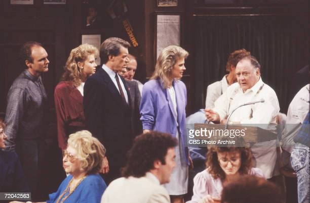 American actor Pat Corley speaks from a podium in a scene from an episode of the television series 'Murphy Brown' entitled 'Summer of '77,' which was...