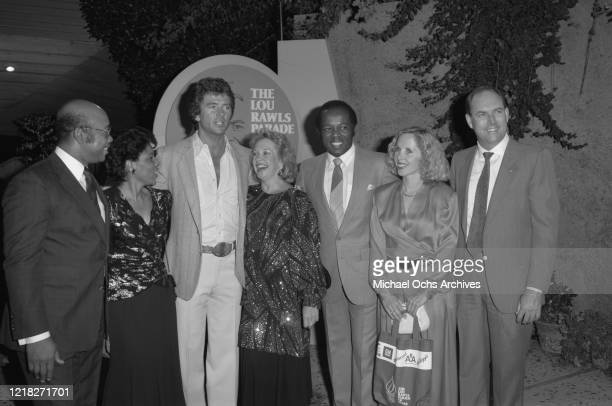 American actor Patrick Duffy and singer Lou Rawls at 'The Lou Rawls Parade of Stars' telethon on aid of the United Negro College Fund, USA, 1986.