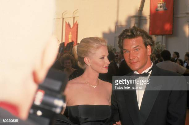 American actor Patrick Swayze and his wife actress Lisa Niemi pose together on the red carpet outside the Shrine Civic Auditorium as they attend the...