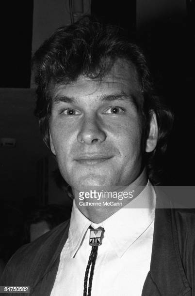 """American actor Patrick Swayze poses for a photo at a party for the premiere of his film """"Dirty Dancing"""" in August 1987 in New York City, New York."""