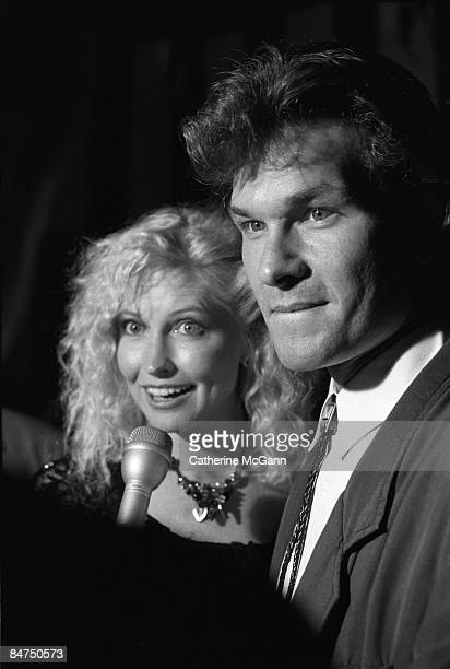 American actor Patrick Swayze right and his wife Lisa Niemi left are interviewed by the media during a party for the premiere of his film Dirty...