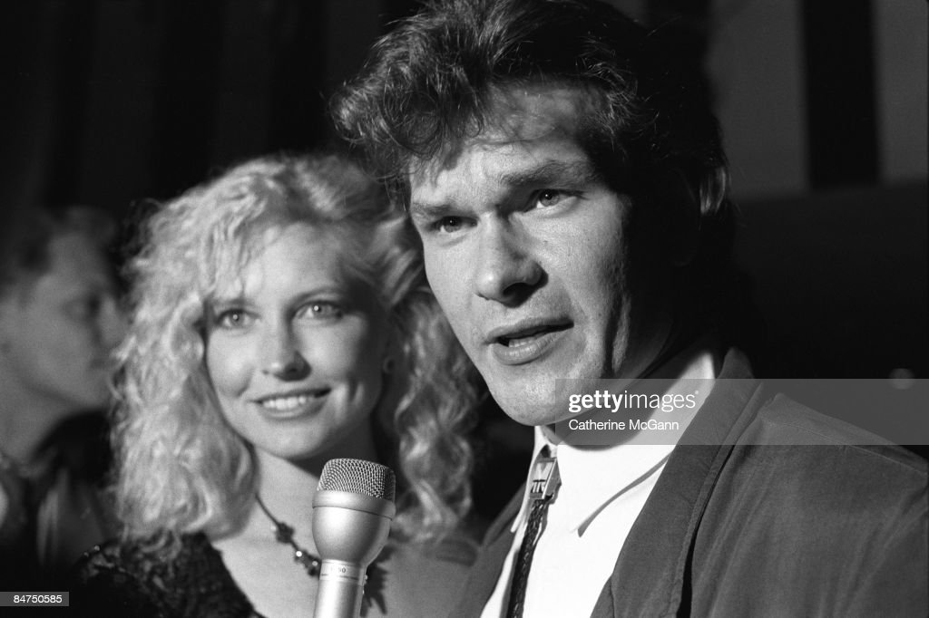 American actor Patrick Swayze, right, and his wife Lisa Niemi, left, are interviewed by the media during a party for the premiere of his film 'Dirty Dancing' in August 1987 in New York City, New York.