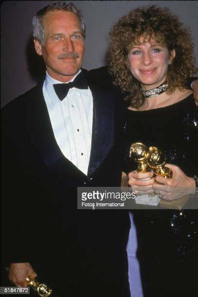 American actor Paul Newman and American singer actress film director and producer Barbra Streisand hold their awards at the 41st Annual Golden Globe...