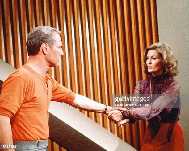 American actor Paul Newman as architect Doug Roberts and Faye Dunaway as his girlfriend Susan in the disaster film 'The Towering Inferno' 1974