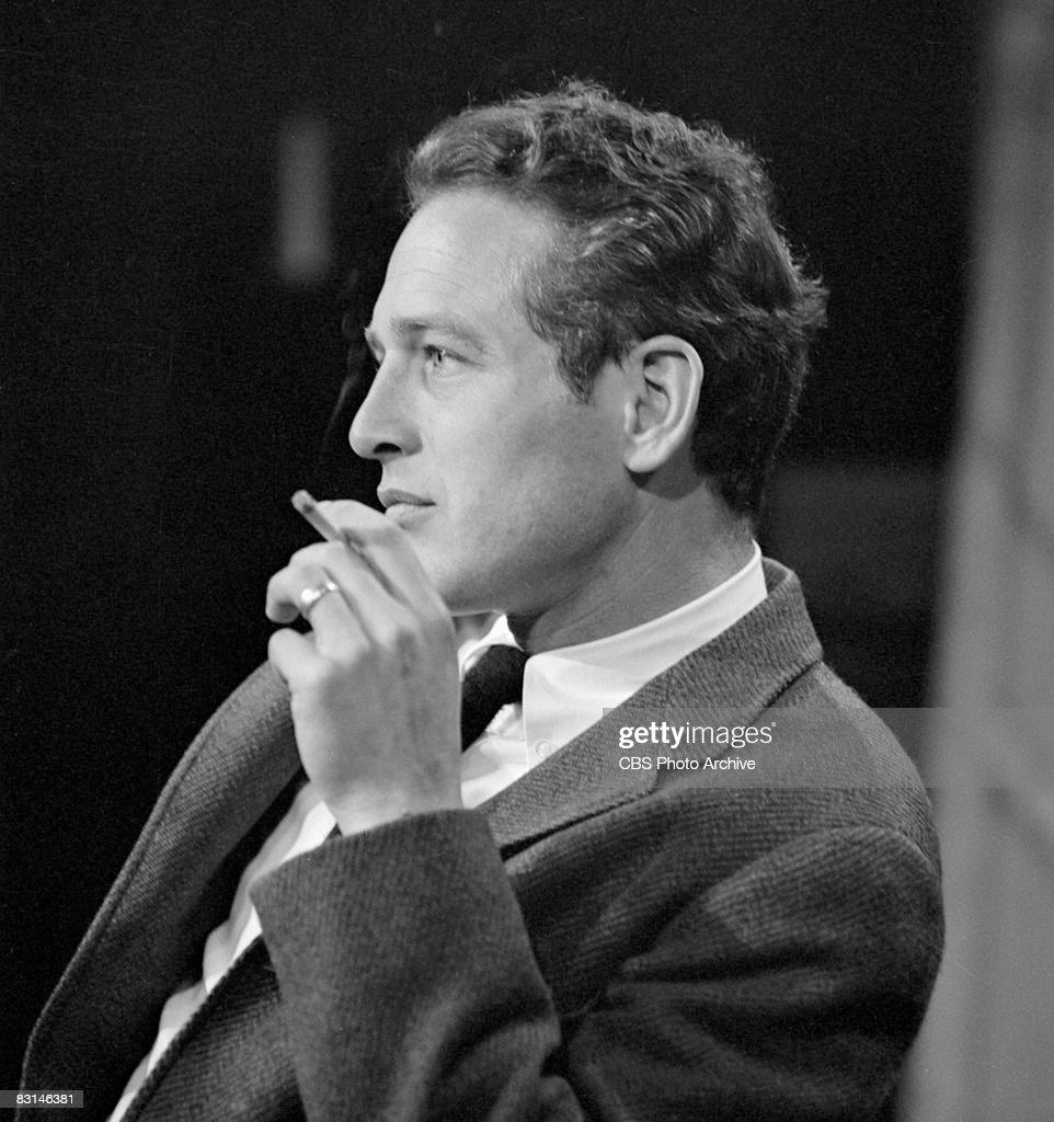 American actor Paul Newman (1925 - 2008) smokes on the set of Sunday morning arts program 'Camera Three,' May 7, 1963.