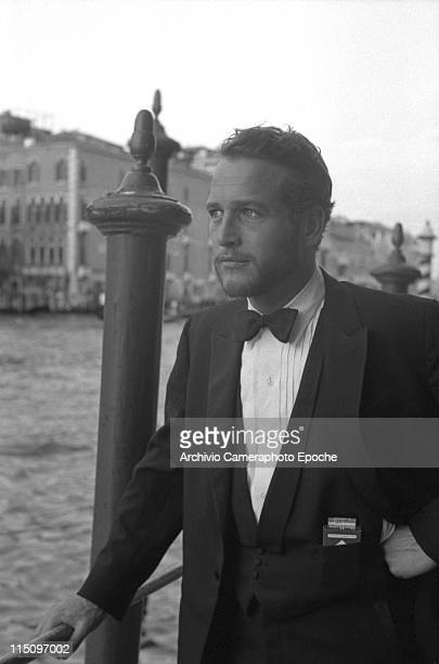 American actor Paul Newman wearing a tuxedo and a bow tie a pack of Red Marlboro cigarettes in his pocket some hooden poles behind him and the Grand...