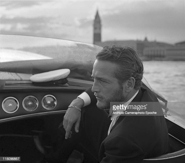 American actor Paul Newman, wearing a tuxedo and a bow tie, portrayed during a trip on a water taxi, a sailor cap on the dashboard, St. Mark Square...