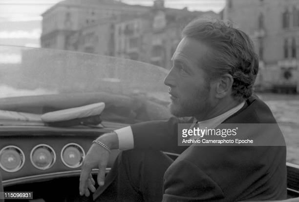 American actor Paul Newman wearing a tuxedo and a bow tie portrayed during a trip on a water taxi a sailor cap on the dashboard Venice 1963
