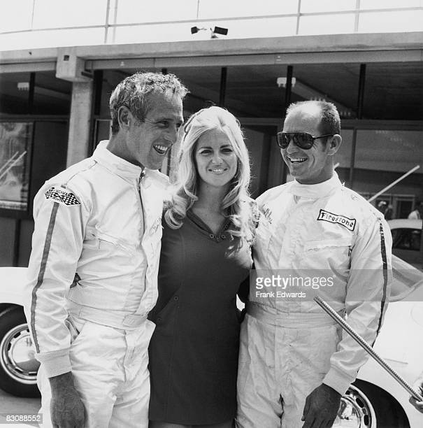 American actor Paul Newman with a raceway hostess and his co-driver American racing driver Parnelli Jones, at the gala pre-opening dedication of the...