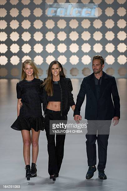 American actor Paul Walker , American model Erin Heatherton and Brazilian model Izabel Goulart show up on a runway after presenting a creation by...