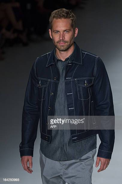 American actor Paul Walker presents a creation by Colcci during the 2013 Summer collections of the Sao Paulo Fashion Week in Sao Paulo, Brazil, on...