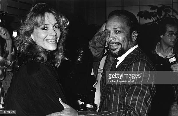 American actor Peggy Lipton and her husband American producer Quincy Jones attend an engagement party for Maria Shriver and Arnold Schwarzenegger...