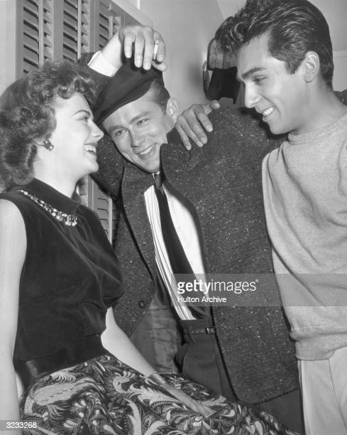 American actor Perry Lopez visits Natalie Wood and James Dean on the set of director Nicholas Ray's film 'Rebel Without a Cause' 1955