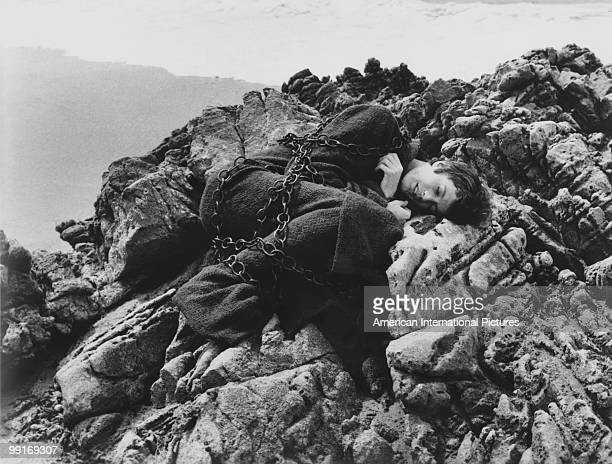 American actor Peter Fonda sleeping in chains in a scene from 'The Trip' California USA 1966 The film was written by Jack Nicholson directed by Roger...