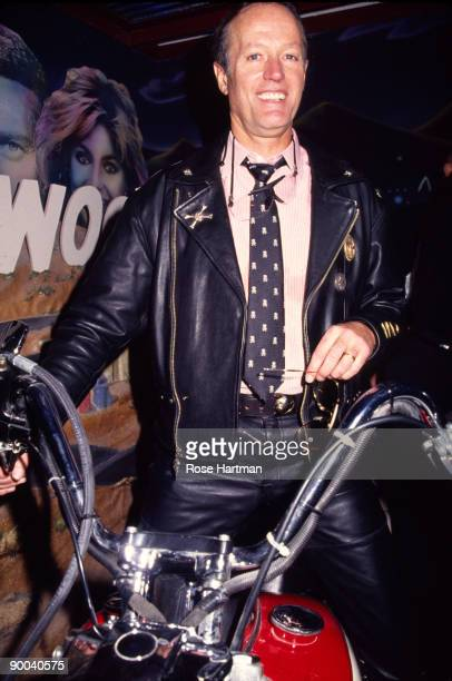 American actor Peter Fonda smiles as he straddles a motorcycle at the grand opening of the Harley Davidson Cafe, New York, New York, October 19,...