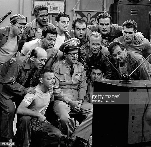 American actor Phil Silvers and the cast of the TV comedy series 'The Phil Silvers Show ' watch a television program August 1956 Included in the...