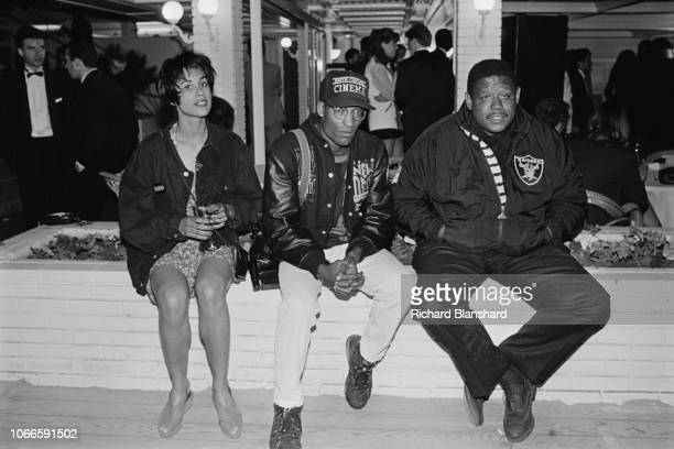 American actor producer and director Forest Whitaker American film director screenwriter and producer John Singleton and guest at the 1991 Cannes...