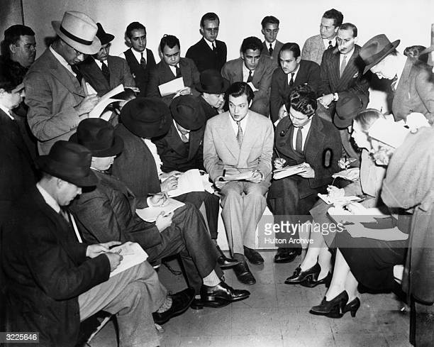 American actor producer and director Orson Welles speaking to a room full of reporters after his radio dramatization of the H G Wells novel 'War of...