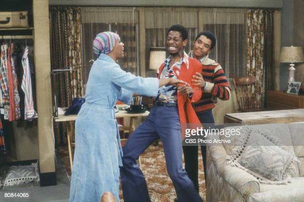 American actor Ralph Carter restrains Jimmie Walker with help from actress Ja'net DuBois in a scene from the television show 'Good Times' Los Angeles...