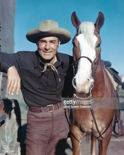 American actor Randolph Scott with his palomino horse Stardust circa 1960