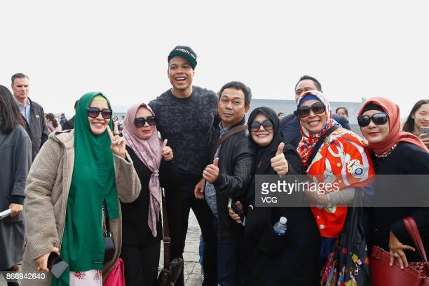 American actor Ray Fisher is surrounded by visitors when visiting the Temple of Heaven on October 27 2017 in Beijing China