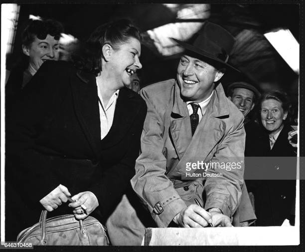 American actor Ray Milland signs autographs during a break in filming at Covent Garden London 1950