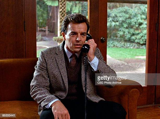 American actor Ray Wise speaks on a telephone in a scene from the pilot episode of the television series 'Twin Peaks' originally broadcast on April 8...
